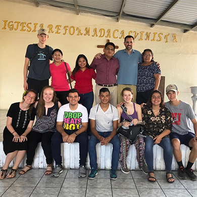 The Brown Memorial delegation to El Salvador pauses for a photo with friends in El Salvador.
